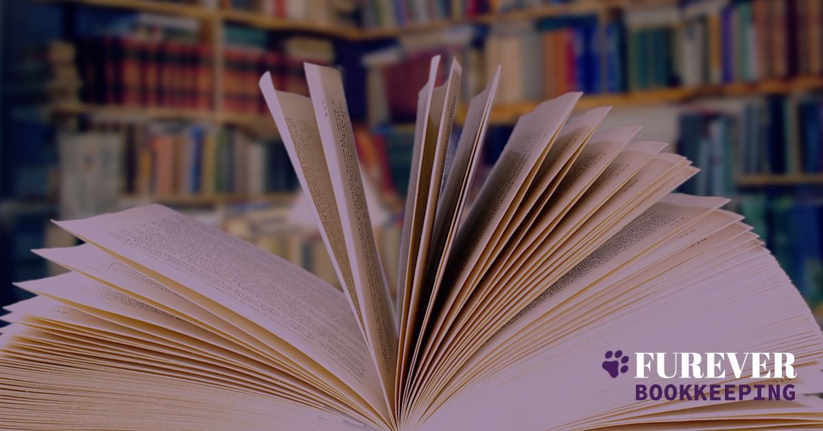 Book laid on spine opened pages flaired Furever Bookkeeping