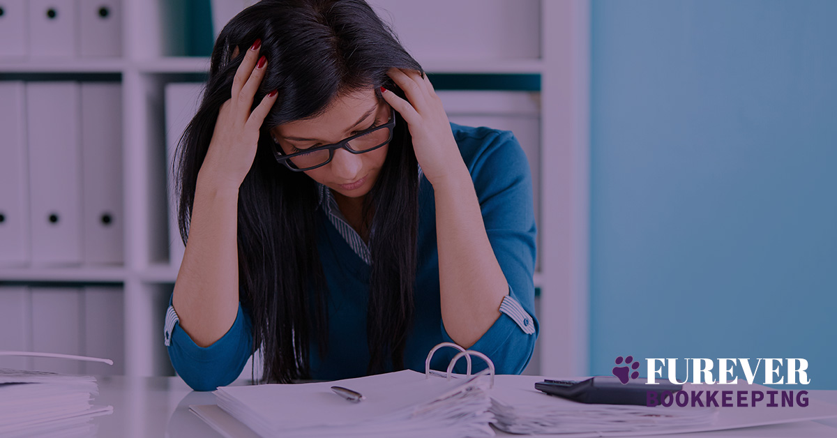 Frustrated female reviewing small business financials Furever Bookkeeping